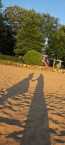 Our shadows at sunset in Black Bay near my grandfather's house in Quebec
