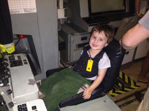 This is our wee man Adam (AKA Batman) in submarine in Sydney harbour on a recent trip to Sydney.
