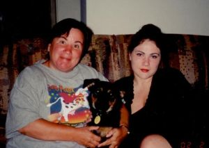 Mom and me mid-fight with my fur child and her fur grandchild Franklin.  He's in doggy heaven now.