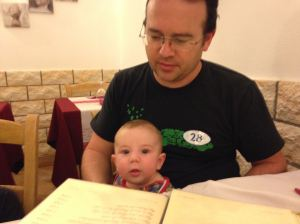 Helping dad read the menu in Roma