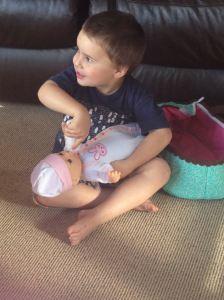Adam feeding his very own baby :-)