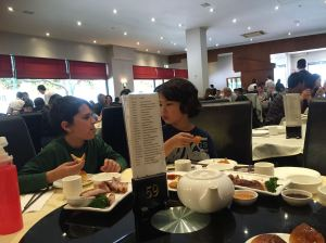 Kids enjoying Yum Cha after a huge hike in the hills